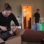 Movers unload the Green Valley Moving truck for a family moving into a new Harrisonburg home on 11/17/15.