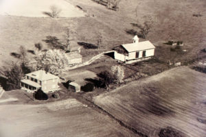 1967 aerial of Evans' farm. The barn is where the auctions and book fair were originally held.