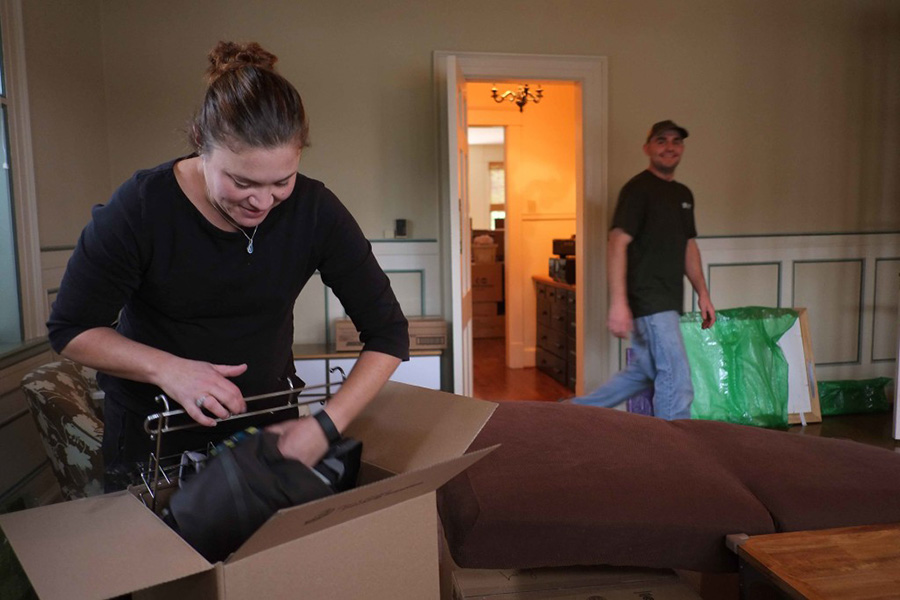 Green Valley Moving employees pack up a house for a move customer