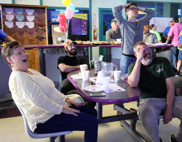 Green Valley Employees laughing as they watch others bowl