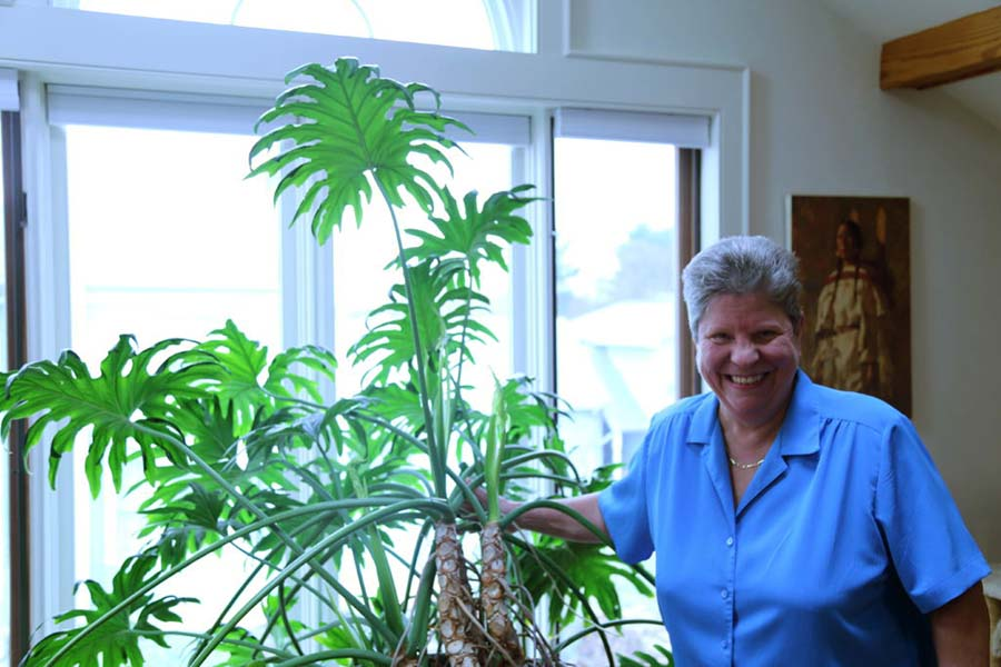 Green Valley moving customer posing with her plants