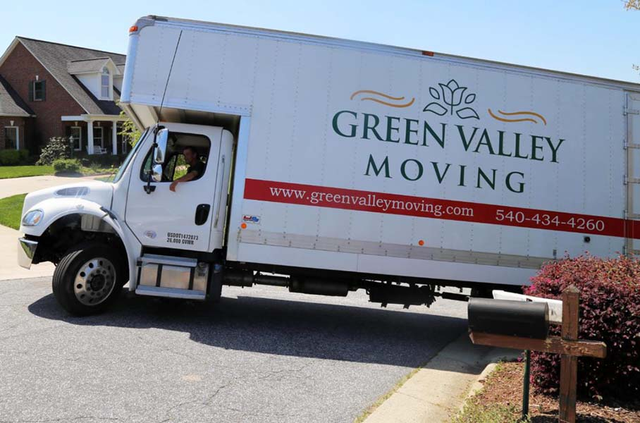 Green Valley Moving truck backing into customer's driveway