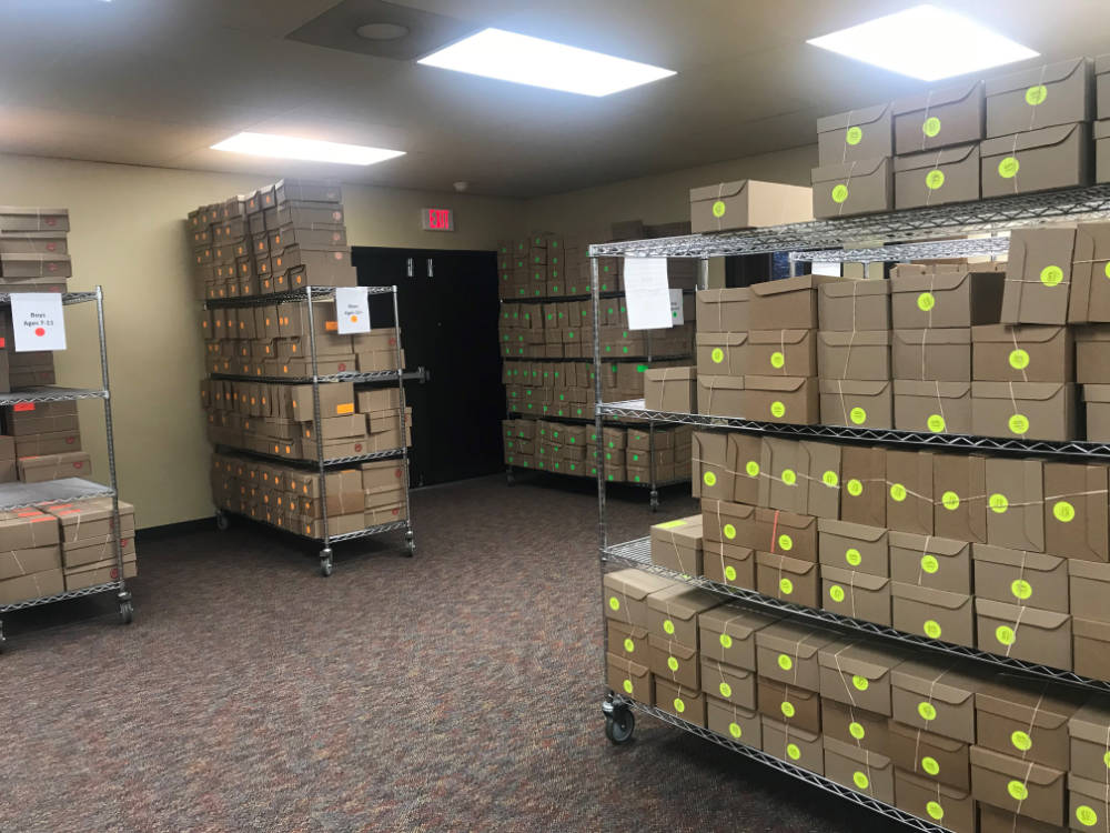 Photo of packed shoe boxes at New Missions
