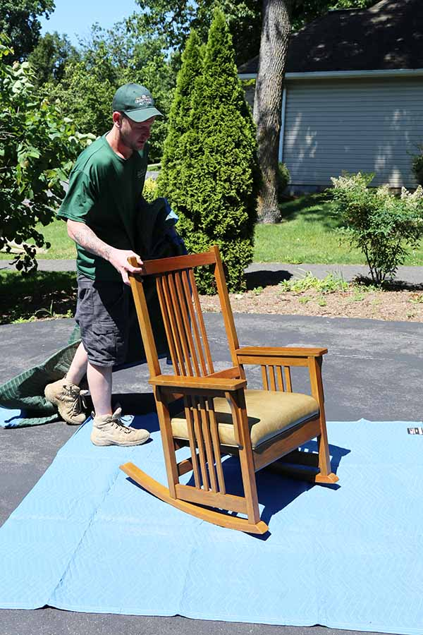 Green Valley Mover works to wrap up a piece of furniture