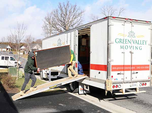 Green Valley Movers loading furniture onto a truck